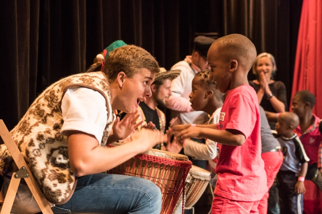 Kingston, Jamaica :: Timo Eschbach (Austria) and the percussion passion group interact with kids from Jamaica Down's Syndrome Foundation during a performance in the Hope Theatre.