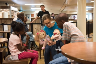 Kingston, Jamaica :: Hannah Davison (Australia) interacts with children using puppets in the I-Cafe.