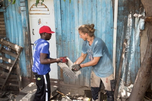 Kingston, Jamaica :: Joel Bokelman (USA) and a local volunteer work side by side to clear rubble after demolishing a house in Kingston.